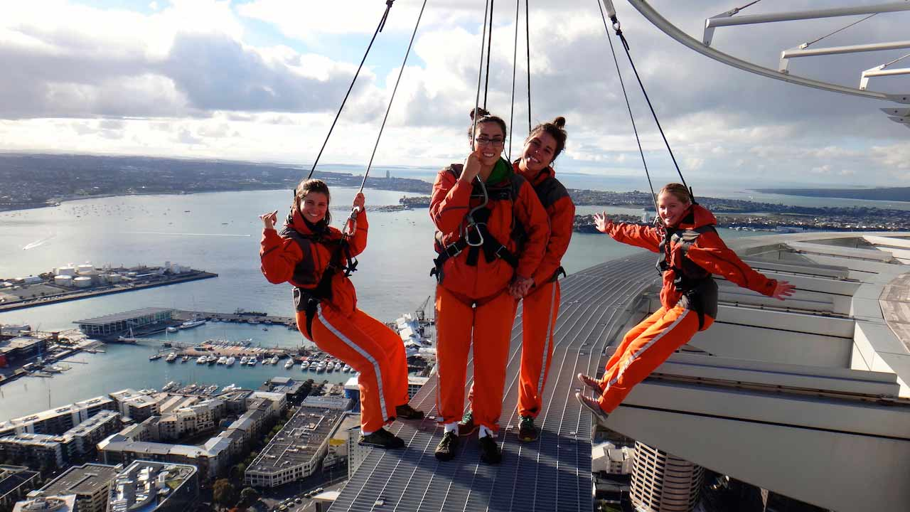 A group of women pose in excitement as they prepare to go bungee jumping off Auckland's Sky Tower