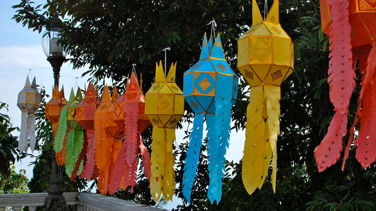 Colorful decorative hangings strewn outside in Chiang Mai
