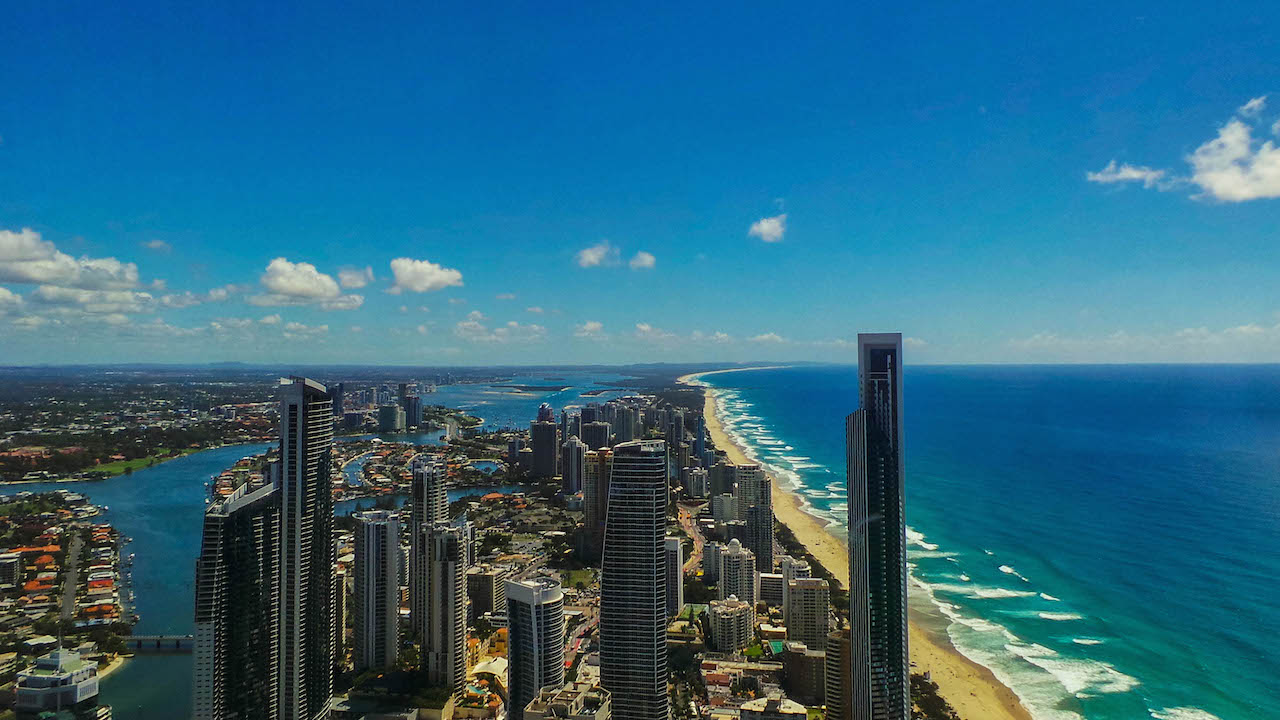 Gold Coast's buildings, beach, ocean and blue sky from above