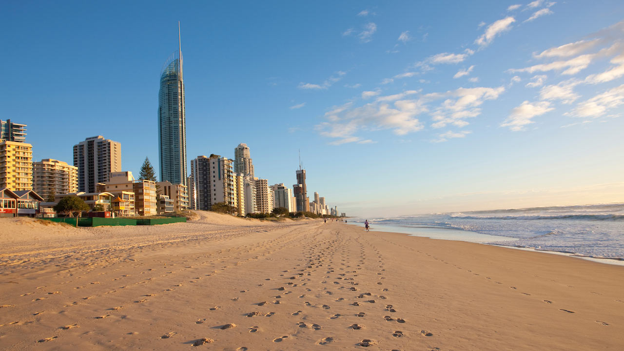 Footprints in the sand on Surfer's Paradise Beach sandwiched between the city line and the ocean