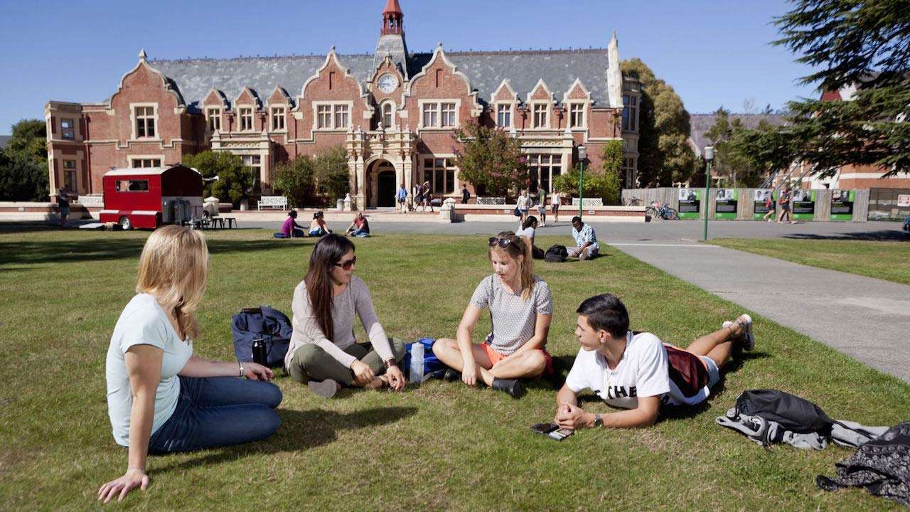 A group of students lay conversing on the quad on Lincoln University's campus