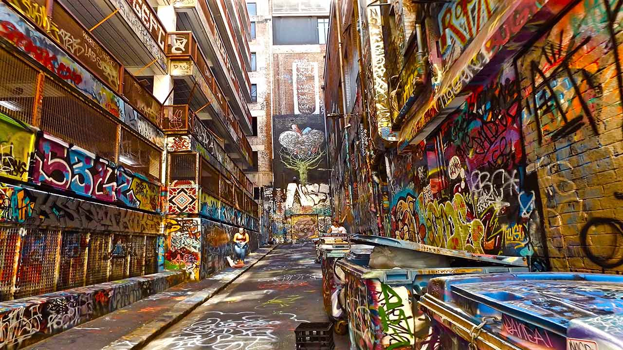 A colorful alleyway in downtown Melbourne that has been covered in graffiti by local artists