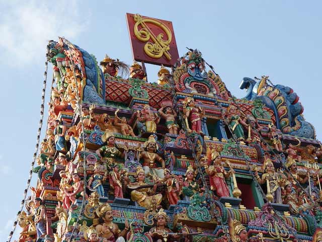 The top of an intricate Hindu temple in Singapore