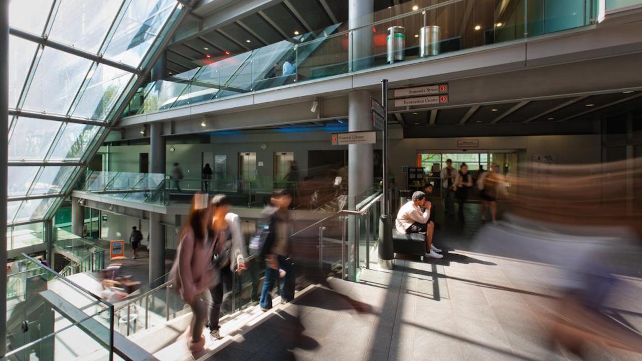 Students in the Kate Edger Centre at the University of Auckland, slow motion blur