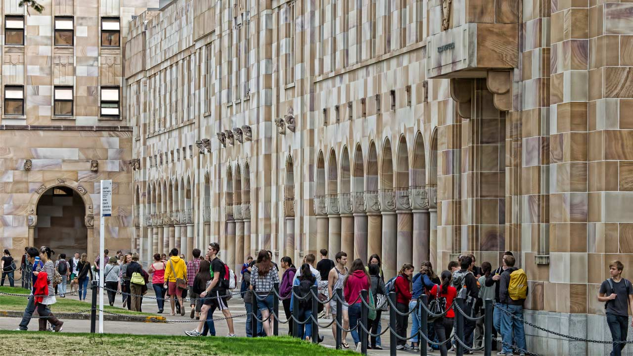 Students use the walkways on UQ's campus to travel between classes