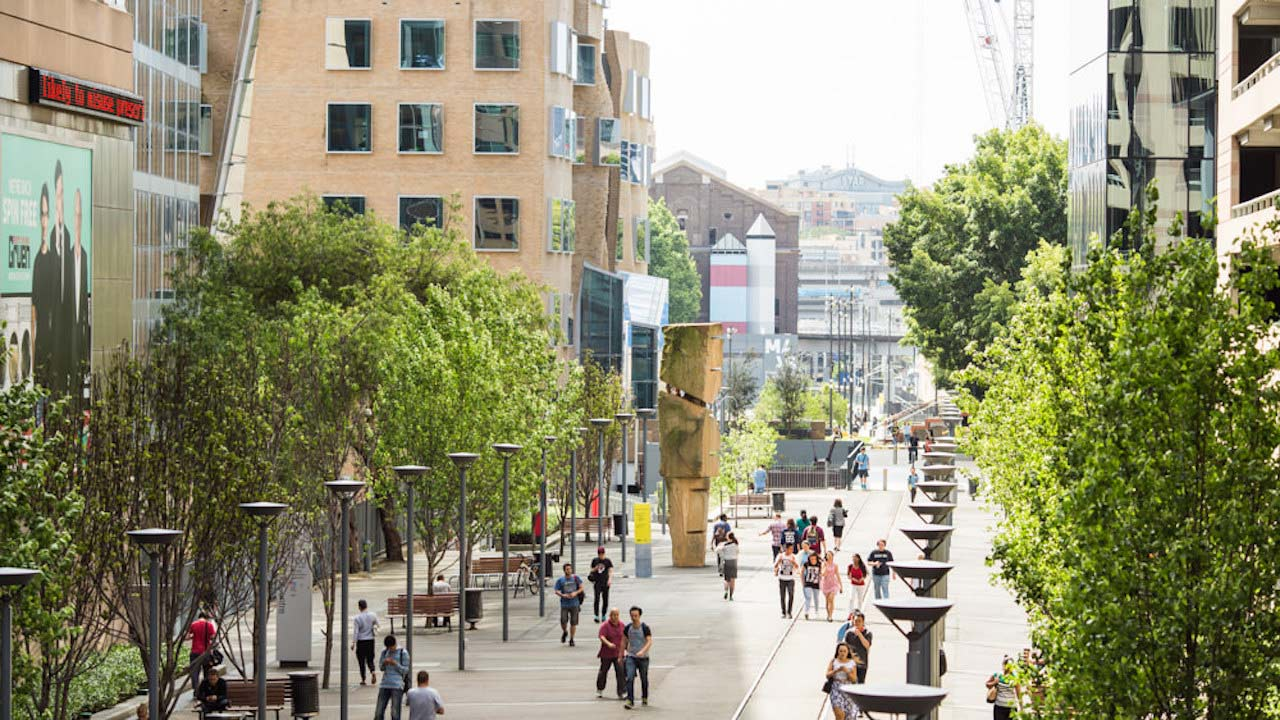 People walking along a main area of UTS's campus