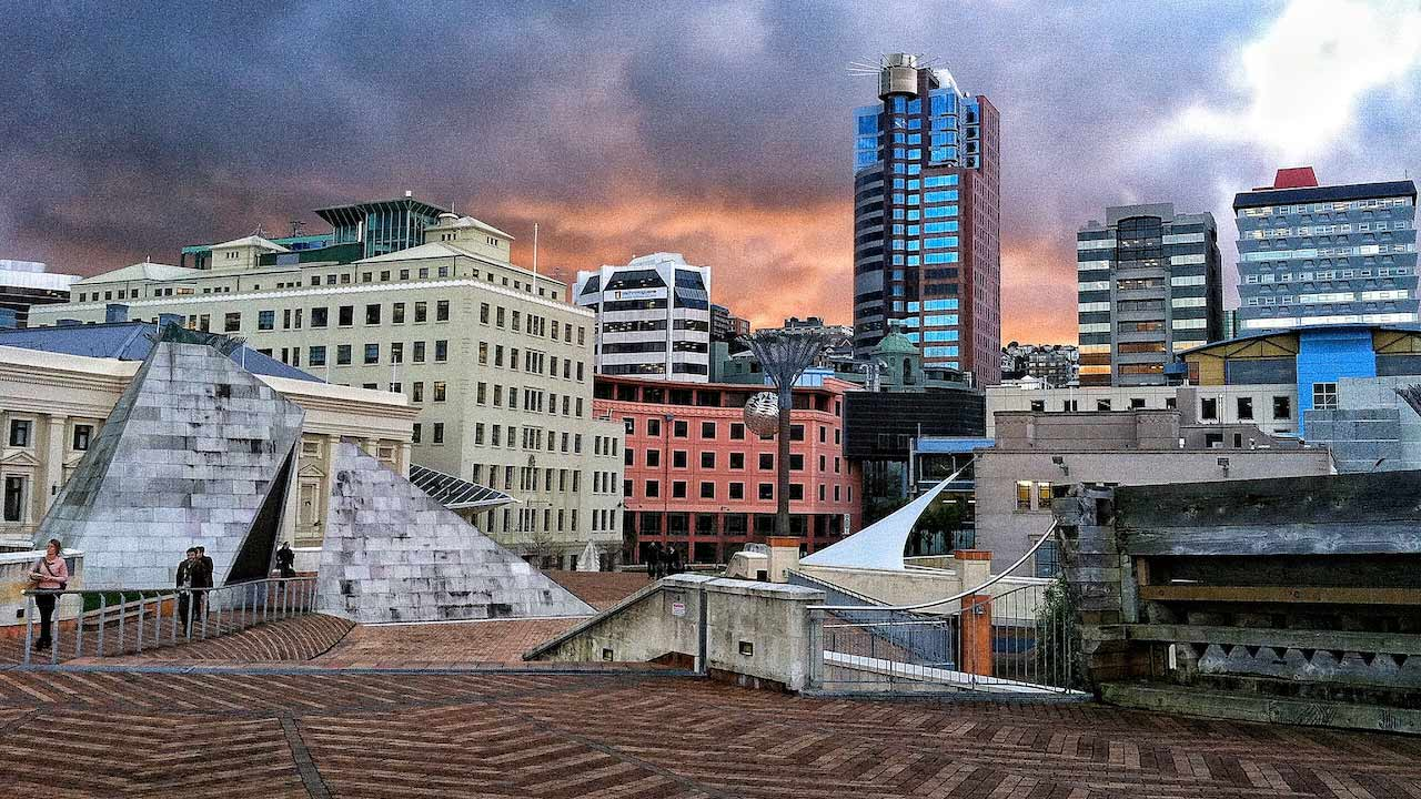 Stormy skies roll in behind downtown Wellington, New Zealand