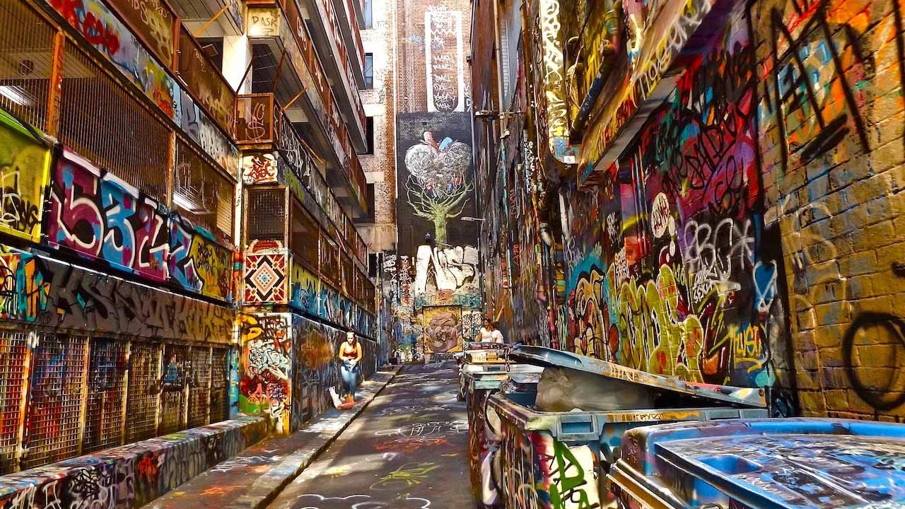 A laneway in Melbourne that is covered in colorful graffiti