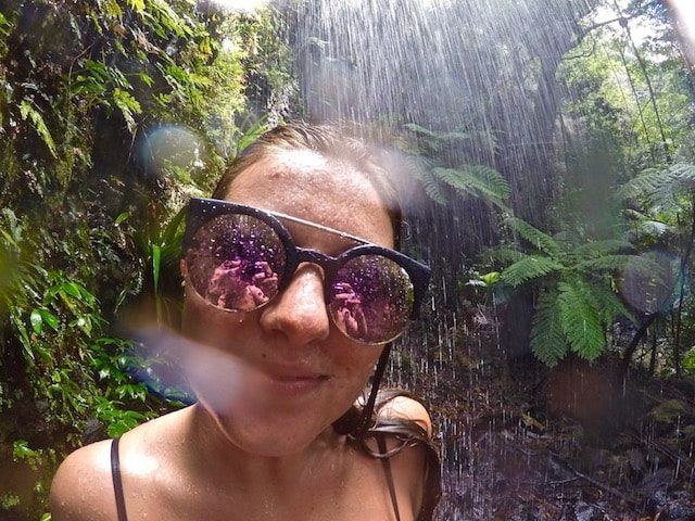 TEAN Student under a waterfall in Springbrook National Park